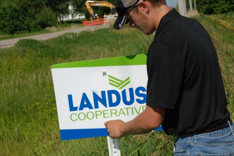 Landus Cooperative Intern putting up field signs
