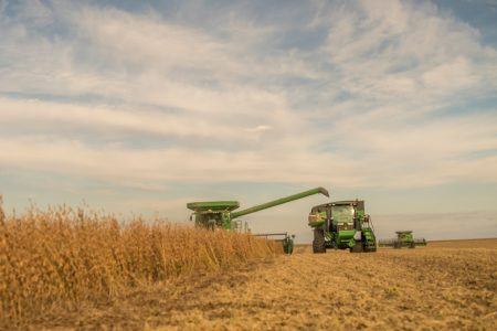 Combine and Tractor in the field for Soybean Harvest